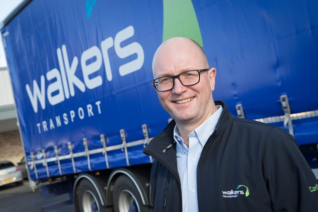 Walkers CEO Richard Simpson stood beside a truck trailer
